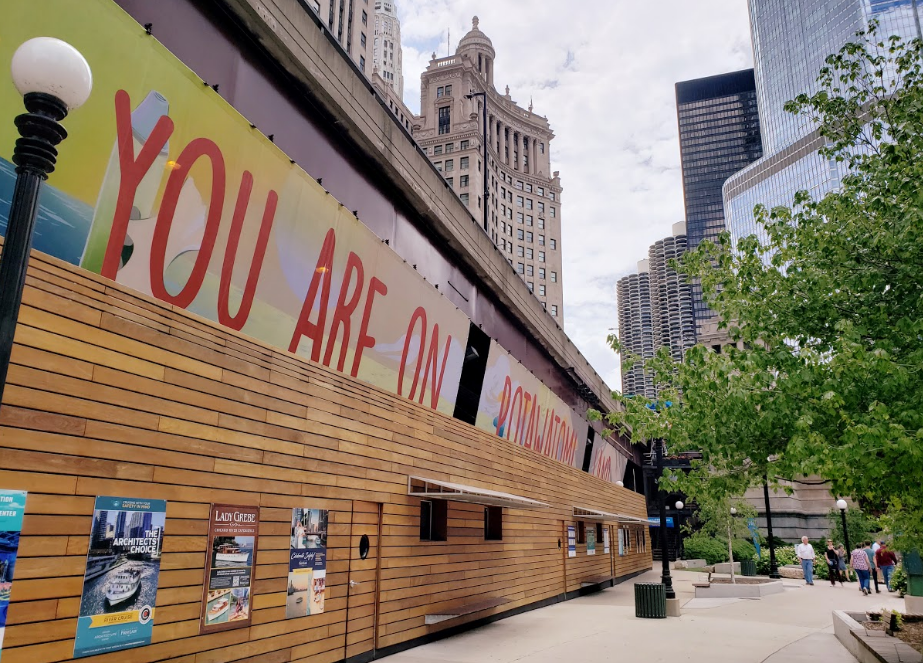 """""""You are on Potawatomi Land"""" above architectural boat tour stands in downtown Chicago. (Photo/Monica Whitepigeon)"""